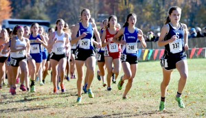 (Arnold Gold-New Haven Register) Hannah DeBalsi (right) of Staples breaks out in front at the start of the Class LL Girls CIAC Championship at Wickham Park in Manchester on 10/31/2015.